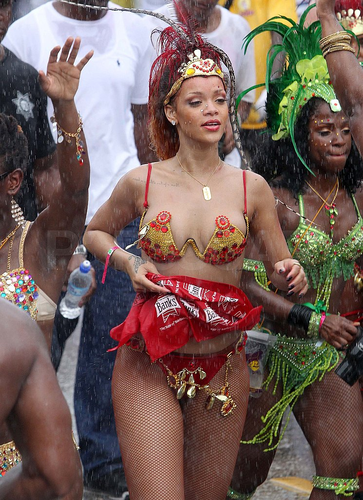 Rihanna wore feathers and a bikini to a Barbados parade.