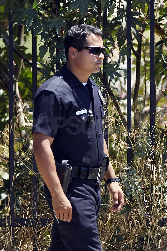 Michael Pena suited up in a police uniform for End of Watch.