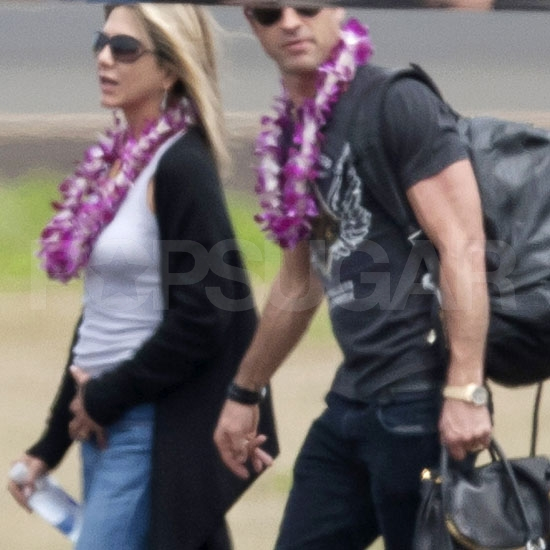 Jennifer Aniston and Justin Theroux arrive in Hawaii.