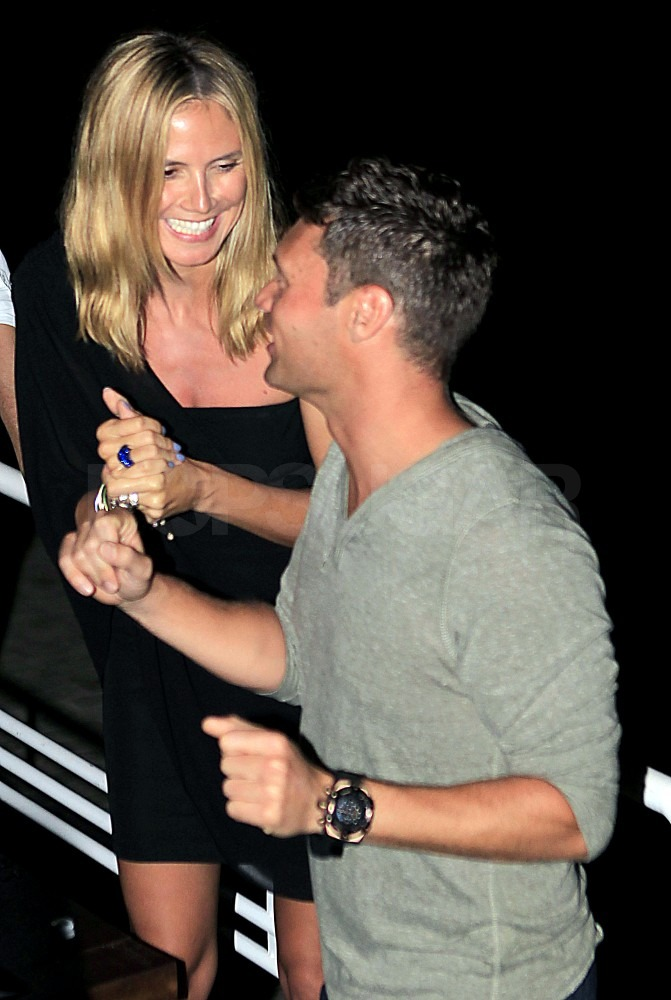 Heidi Klum ran into Ryan Seacrest in Ibiza, Spain.