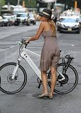 Blake Lively  walks her bike.
