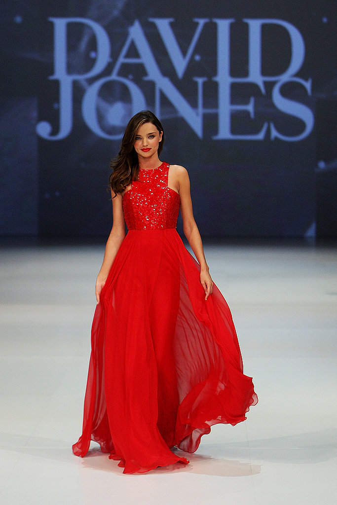 Miranda Kerr in a long red dress.