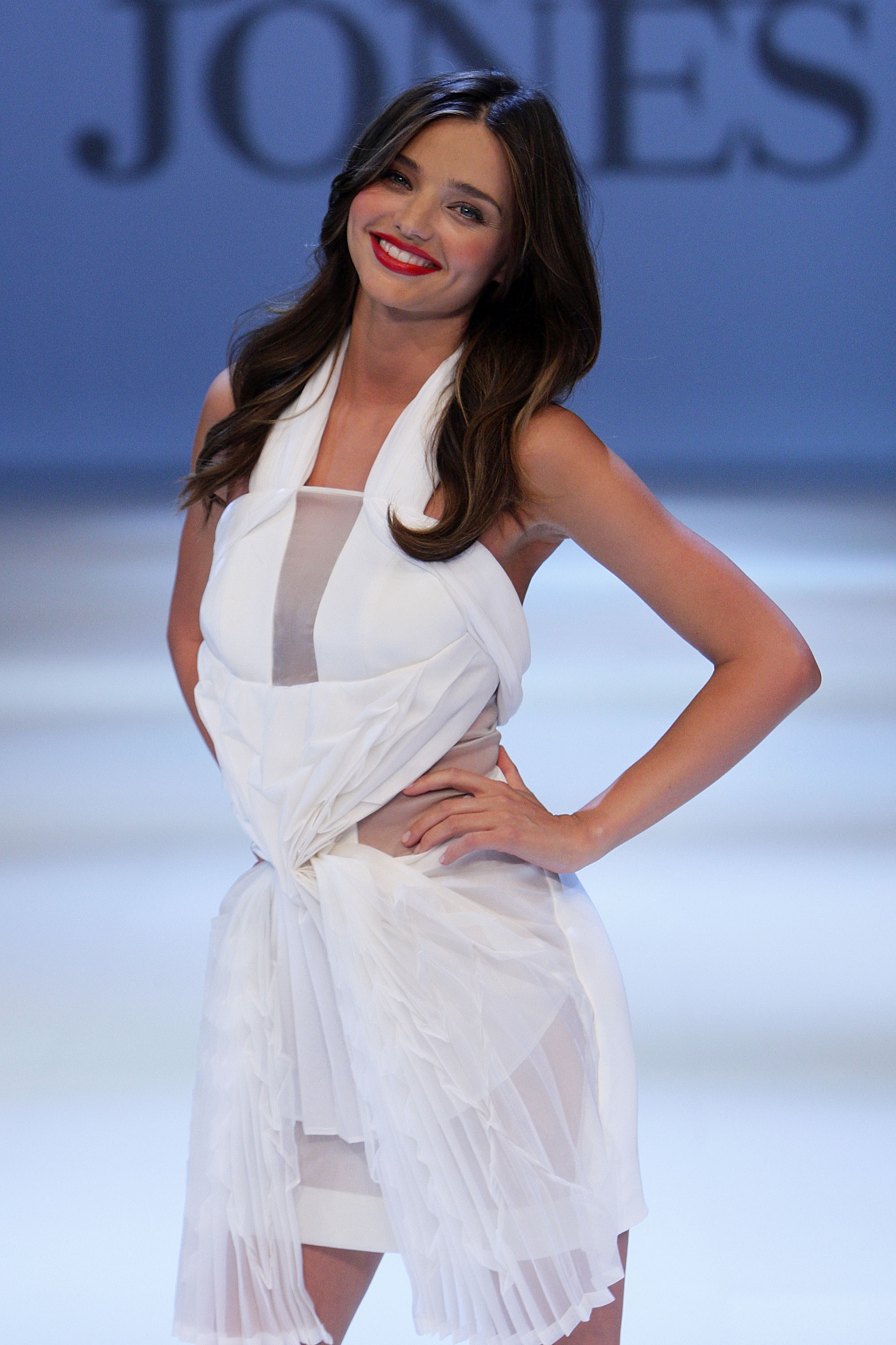 Miranda Kerr smiles in white.