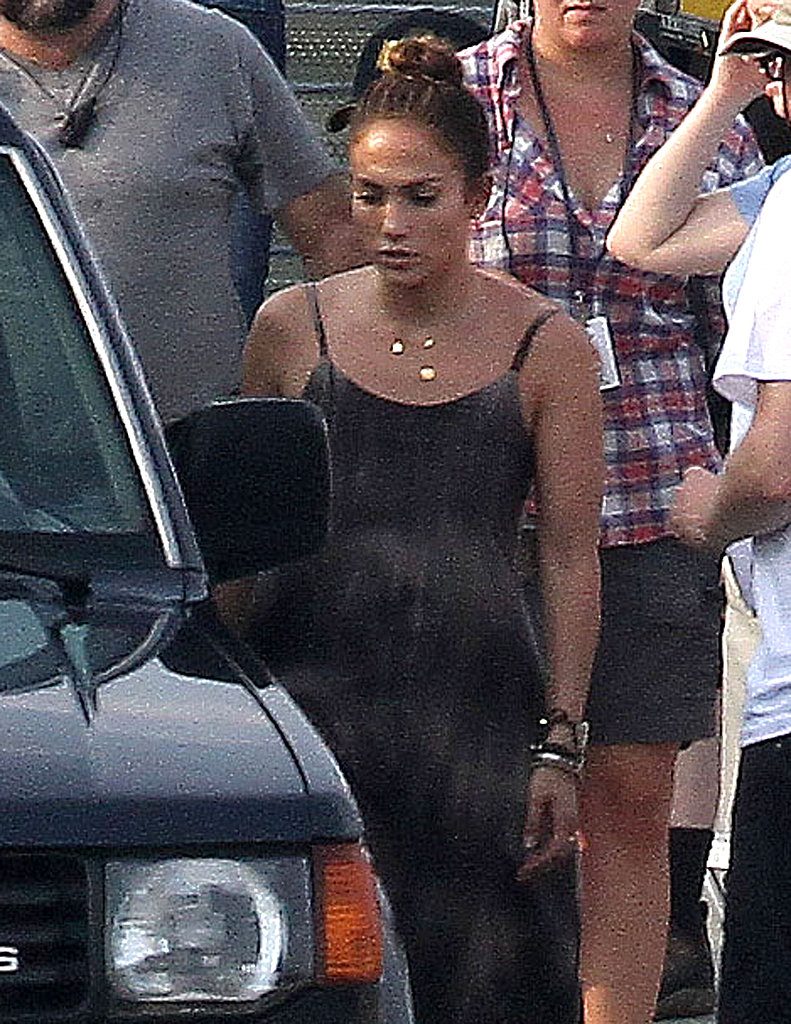 Jennifer Lopez was flanked by crewmembers.
