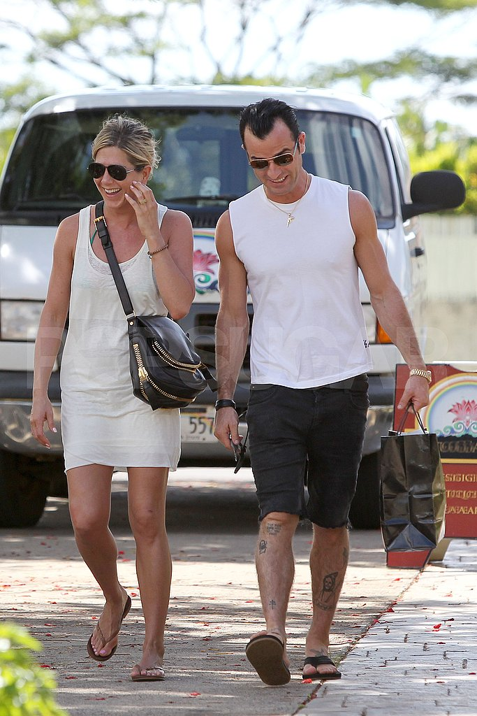 Jennifer Aniston and Justin Theroux laughing together.