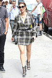 Kim Kardashian wore a plaid wrap dress.