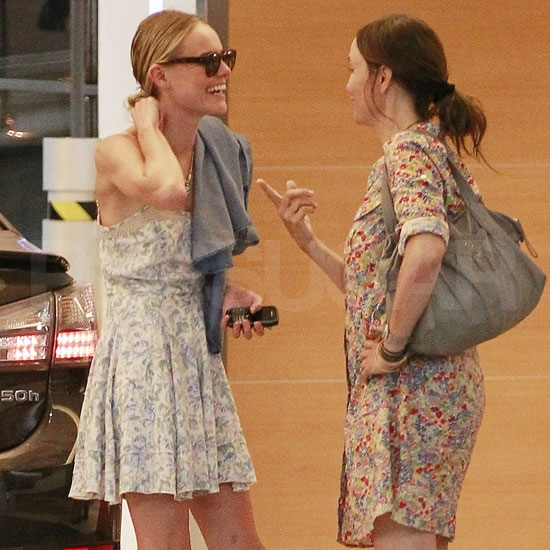 Kate Bosworth slung a sweater over her shoulder.