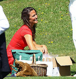 Pippa sat for a picnic with friends.