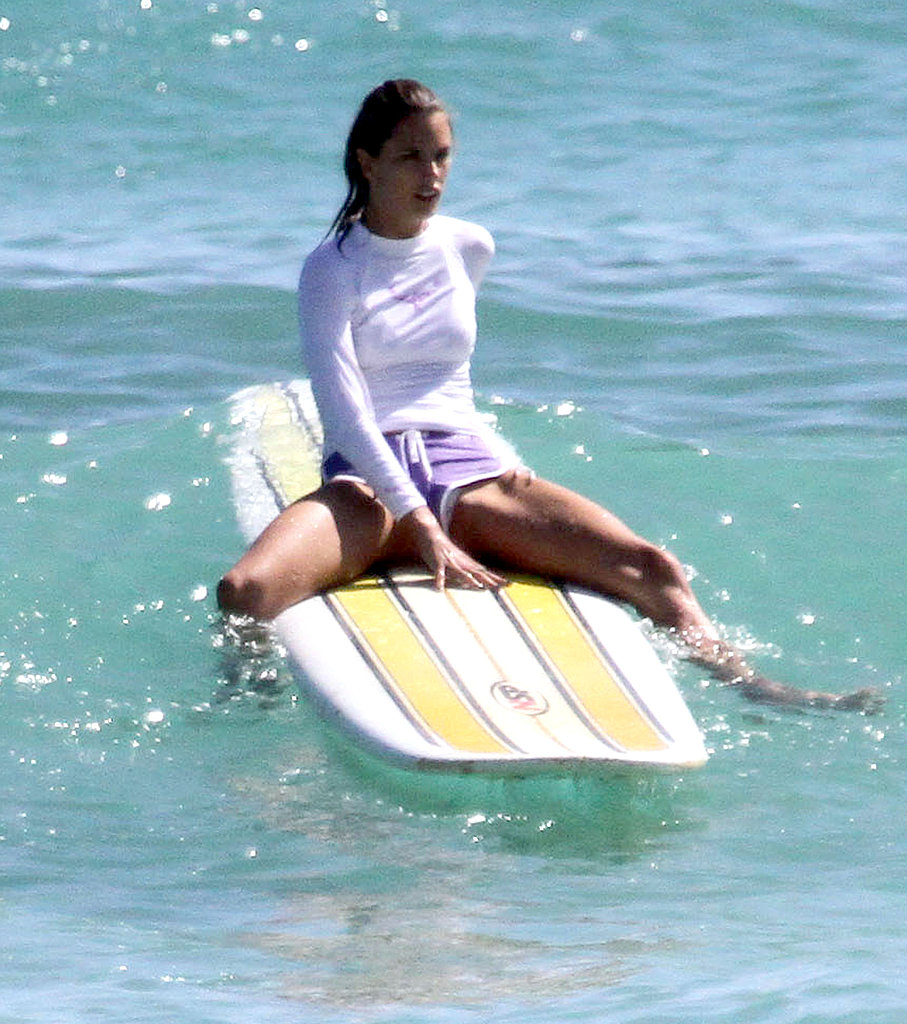 Alessandra Ambrosio on a surfboard.