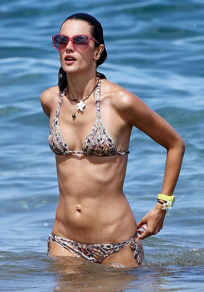 Alessandra Ambrosio with a bikini and yellow watch.
