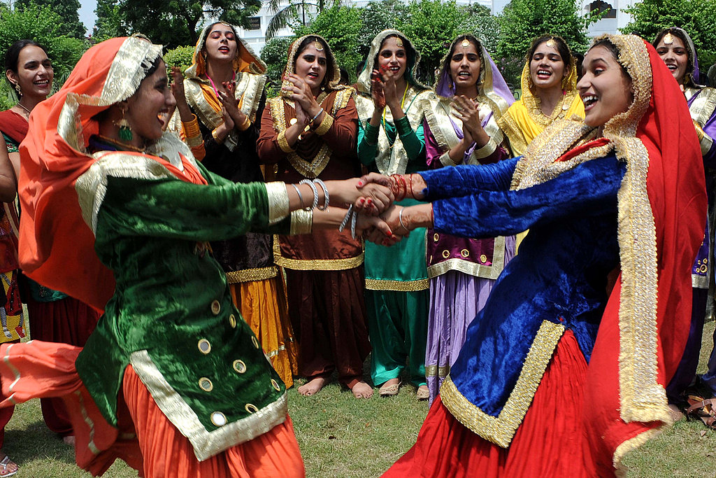 Indian girls dance during the Teej festival at Khalsa college for women in Amritsar.