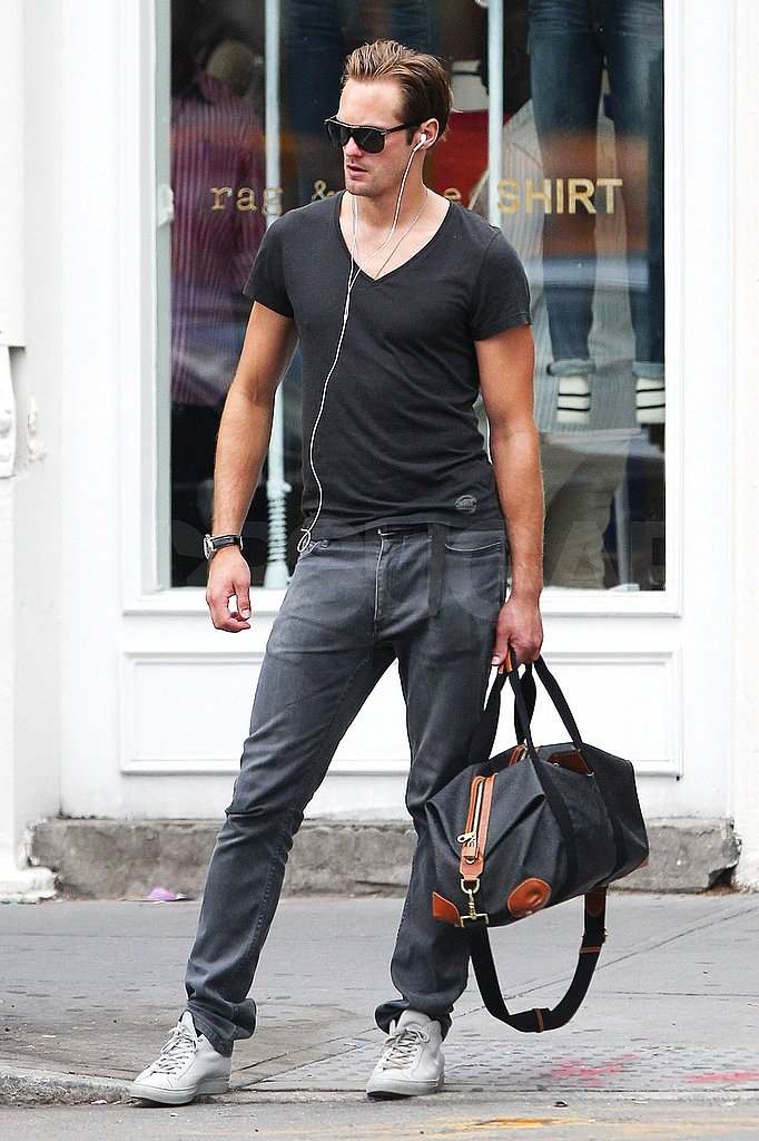 Alexander Skarsgard poses on the sidewalk.