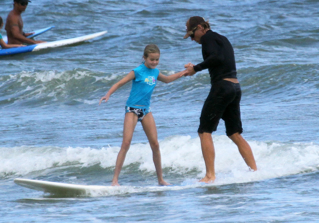 Ava Phillippe learning to surf.