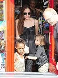 Angelina Jolie holding hands with Zaraha Jolie-Pitt  and Shiloh Jolie-Pitt.