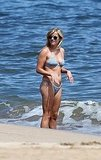 Reese Witherspoon shows her stomach tattoo in a bikini.