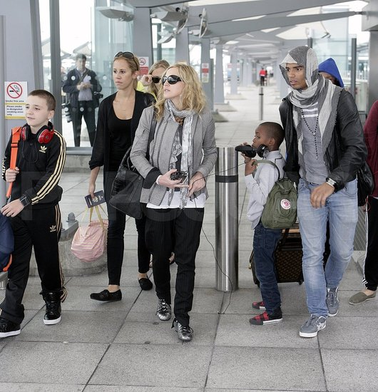 Madonna arrives in London with Rocco and David.