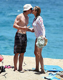 Julia Roberts and Danny Moder kissing on the beach.