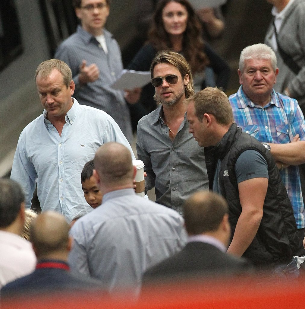 Brad Pitt carries a coffee at Euston.Br
