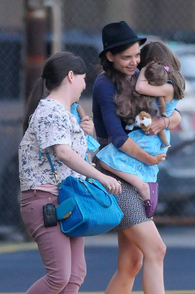 Katie Holmes carries Suri Cruise in NYC.