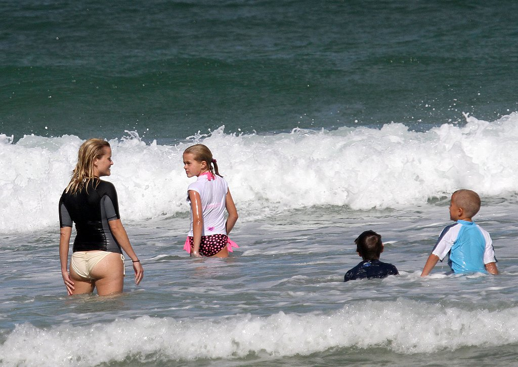 Reese Witherspoon Wears a White Bikini For a Surf Day With Ava and Deacon