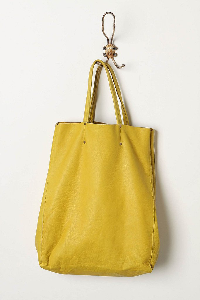 This sunny tote can easily fit a laptop and a few books. Bright Eyes Tote ($198)