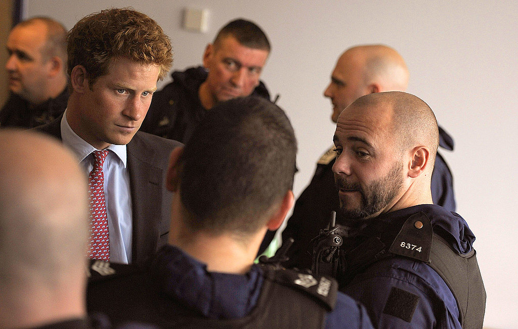 Prince Harry chats with police officers.