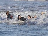 David Beckham, Romeo Beckham, and Brooklyn Beckham enjoyed a ride on the waves.