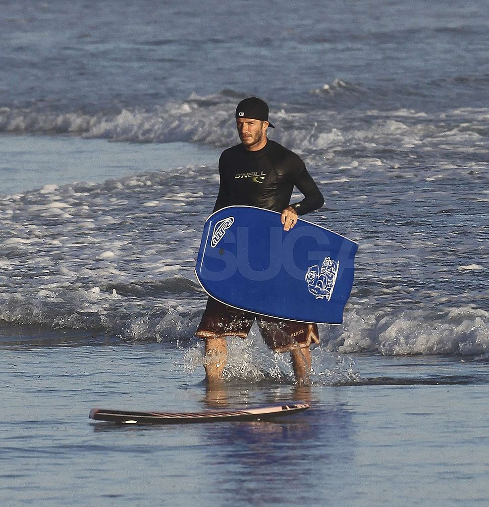 David Beckham carried a boogie board.