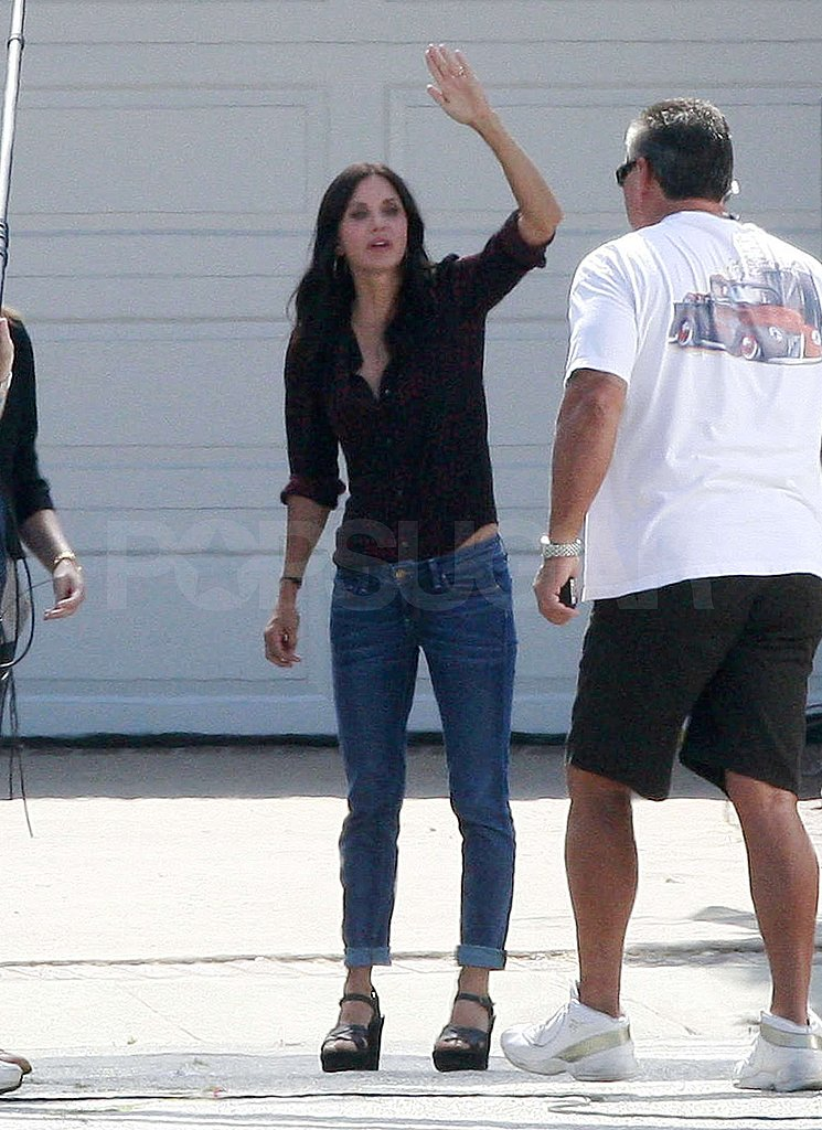 Courteney Cox chatted with a crew member.