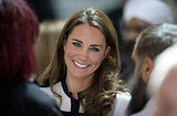Kate Middleton smiles while speaking with riot victims and responders.