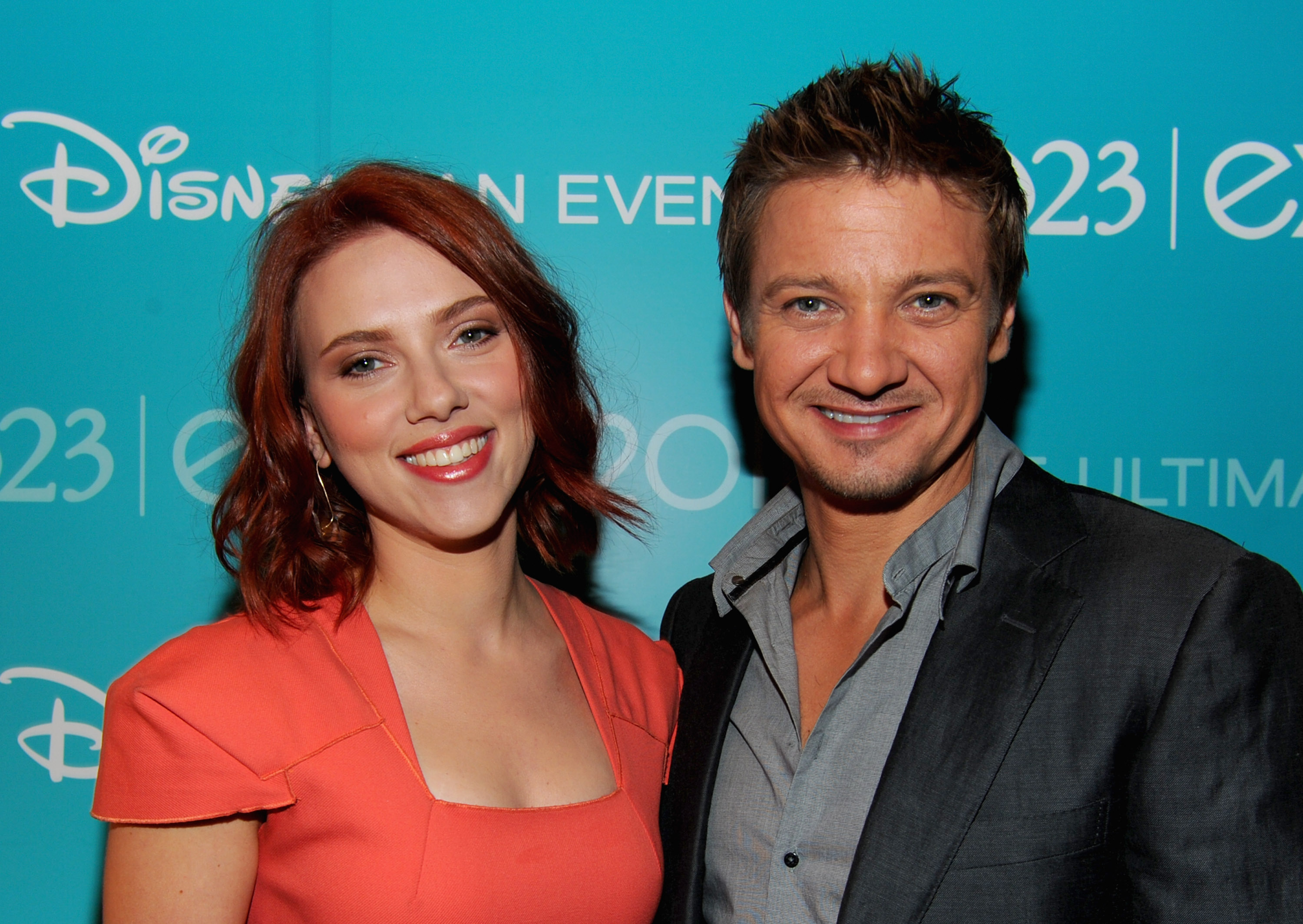 Jeremy Renner and Scarlett Johansson flashed smiles backstage.