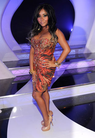 Snooki rocked her trademark tan and a cocktail dress.