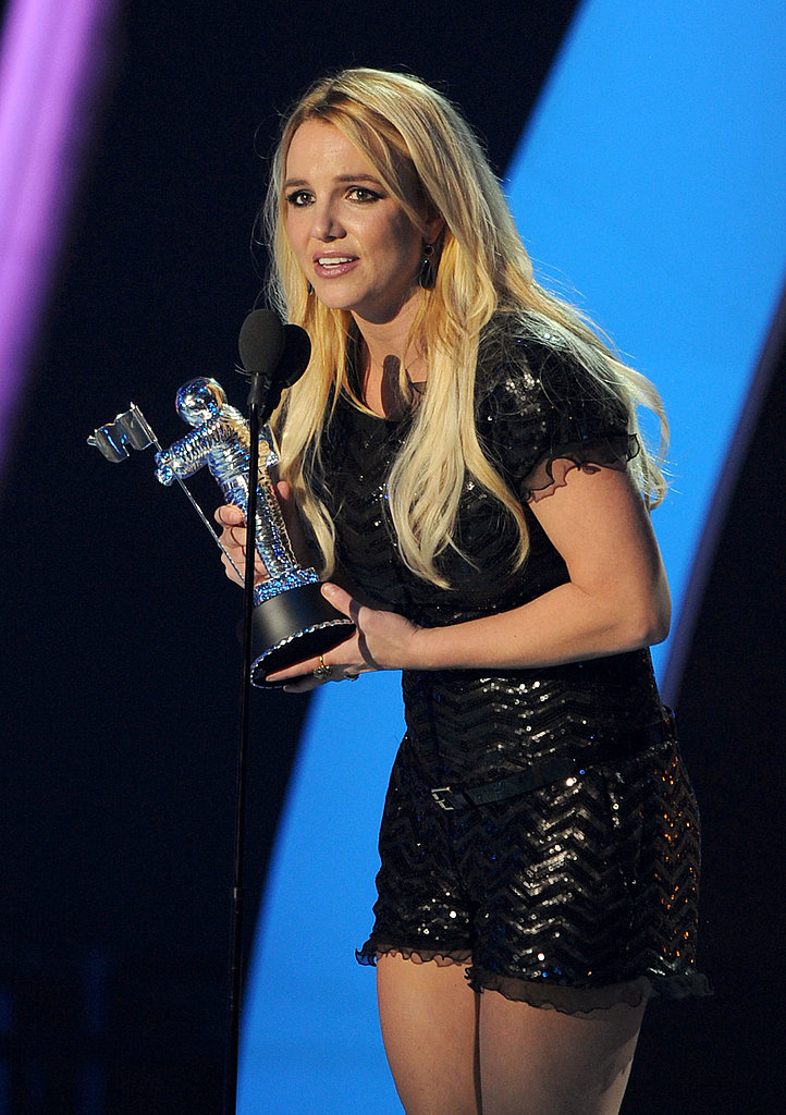 Britney Spears accepts an award at the 2011 MTV VMAs.