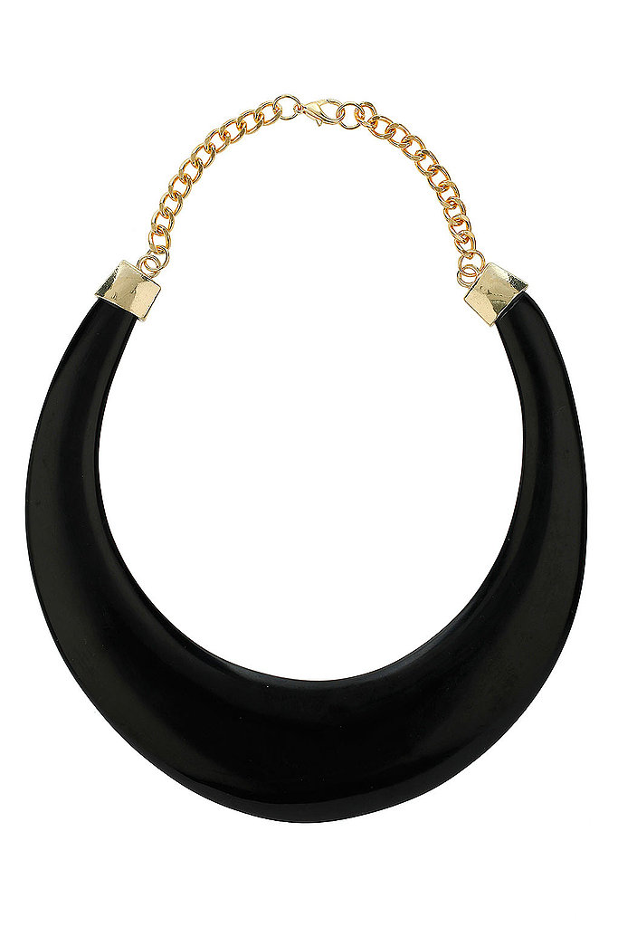 We'd wear this elegant piece on date night, or right alongside our go-to white tank.   Topshop Plastic Torque Necklace ($30)