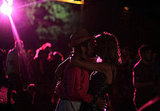 These festivalgoers smooched in the moonlight (and florescent light) of Glastonbury festival.