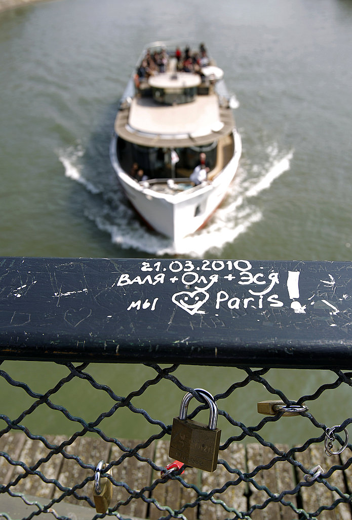 Love locks are attached to a bridge in Paris.