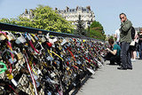People looked at the love locks on the Archeveche bridge in Paris.