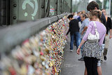 A couple looks at the love locks on Hohenzollernbruecke bridge in Cologne, Germany.