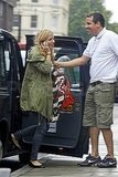 Sienna Miller got a friendly hand exiting her car.
