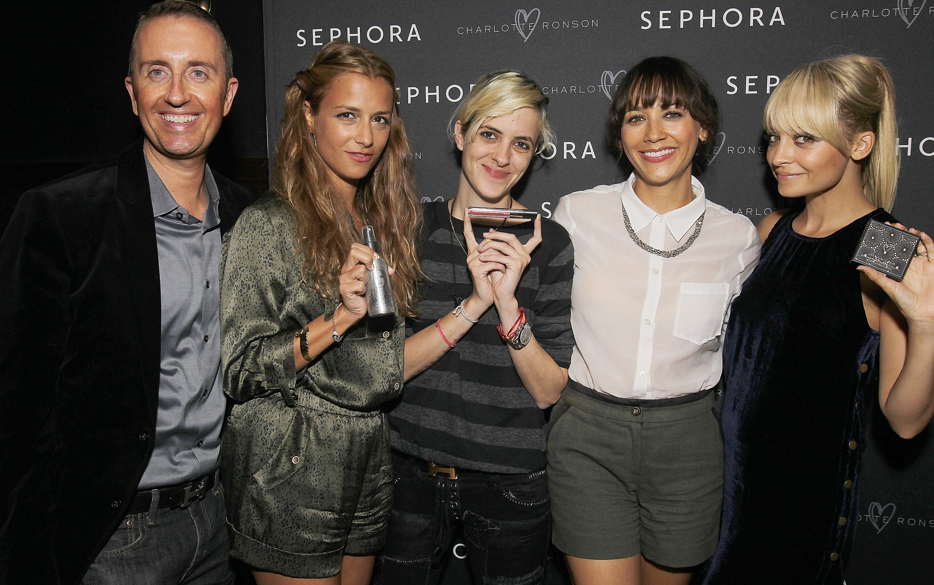 The girls all held up the Charlotte Ronson Beauty products.