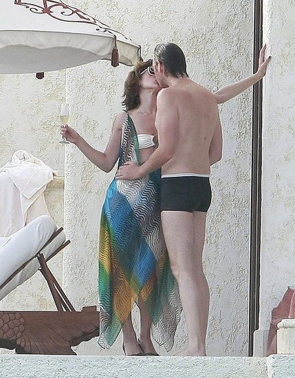 Bikini-Clad Milla Jovovich and Her Husband Share Champagne Kisses in Cabo