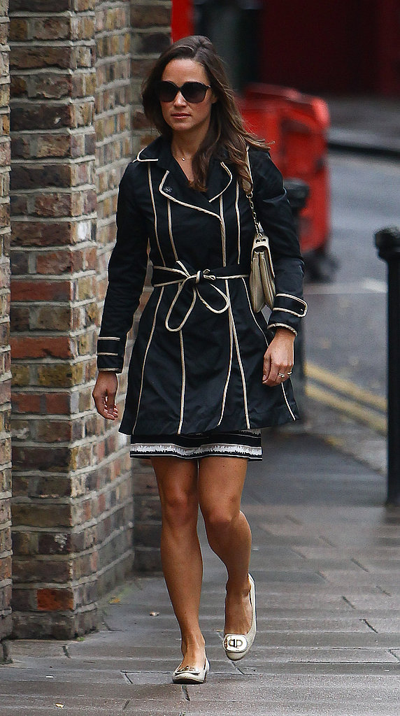 Pippa wore a chic raincoat to deal with the weather.