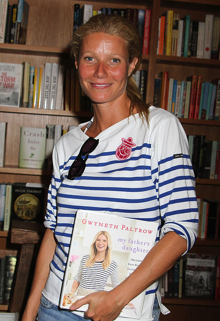 Gwyneth Paltrow posed for a photo holding her book.
