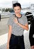 Miranda Kerr waves in Australia.