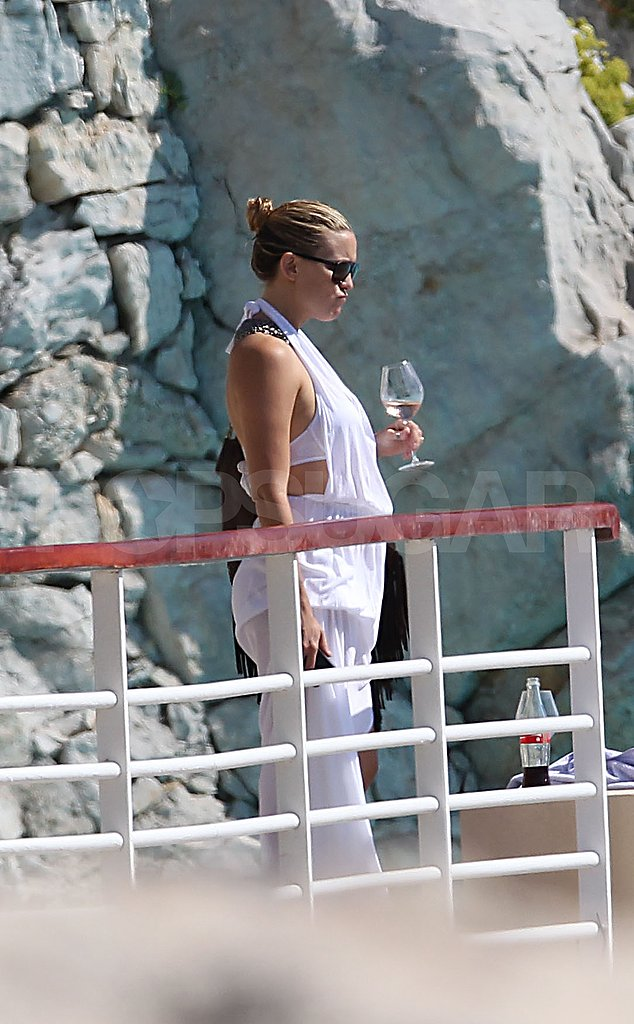 Kate Hudson with a glass of wine.