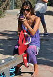 Alessandra Ambrosio takes pictures with her phone.