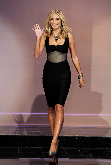 Heidi Klum showed off her supermodel shape in a corset dress.