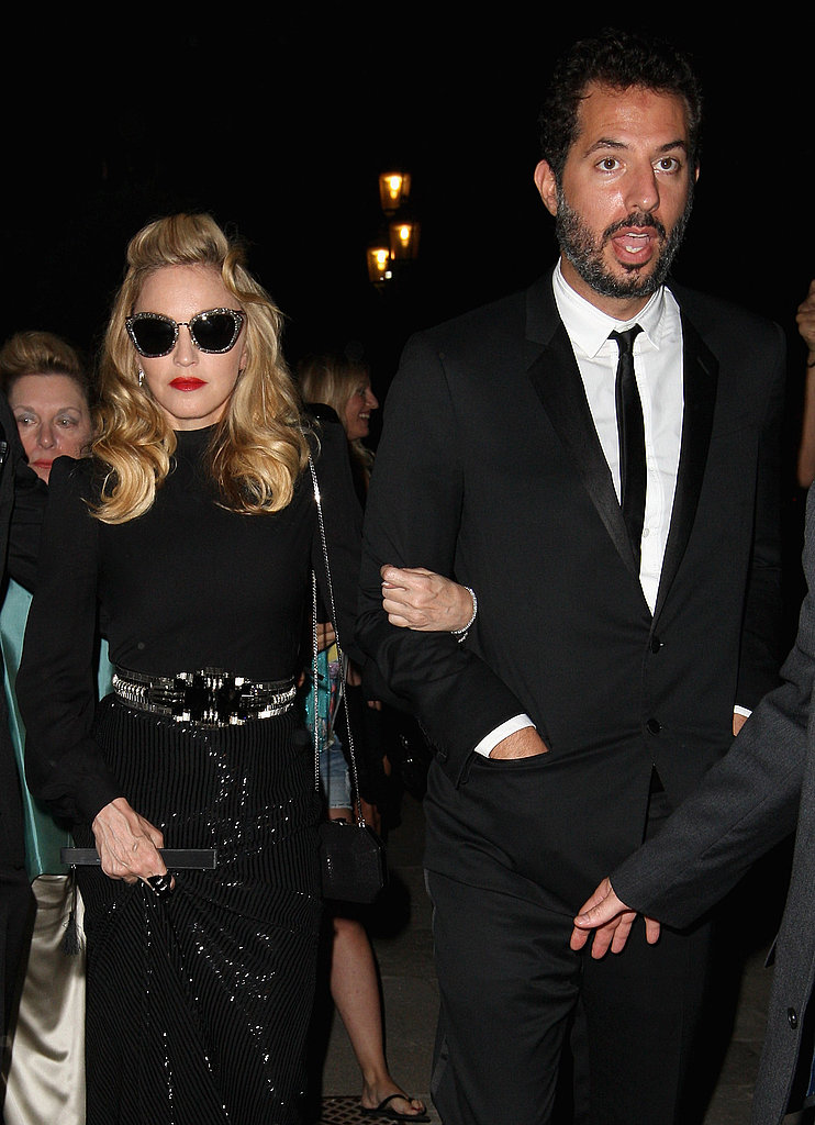 Madonna kept her shades on as she arrived with her manager Guy Oseary.