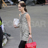Leighton Meester carried a bright red bag.