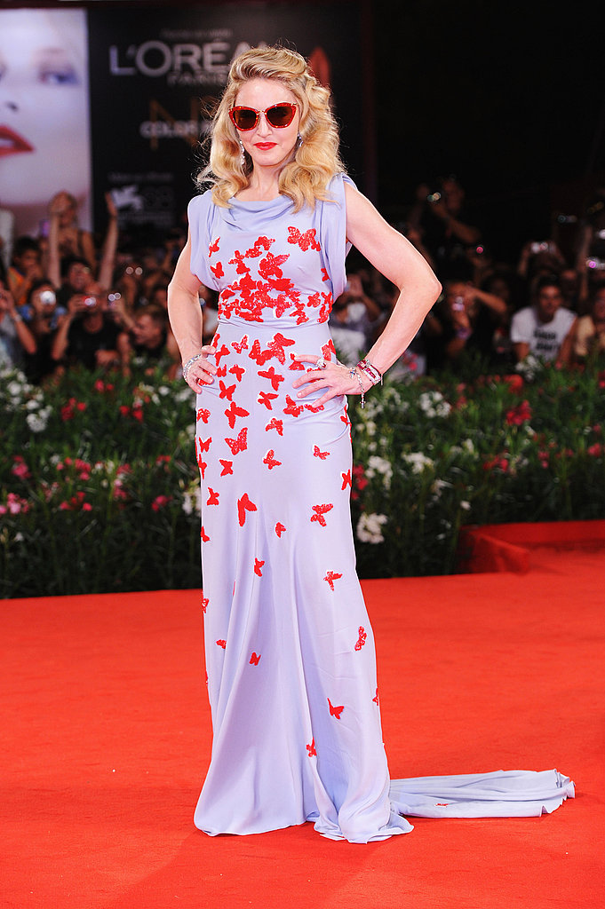 Madonna donned a beautiful butterfly-print gown by Vionnet and completed the look with red Miu Miu sunnies.